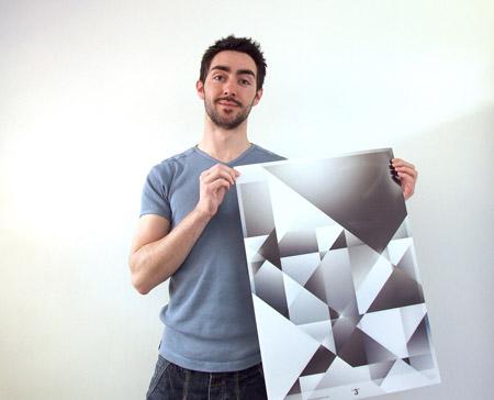 Chris Spooner holding 3 poster