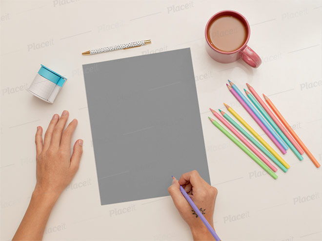 Sketch Paper Mockup Featuring a Woman Coloring