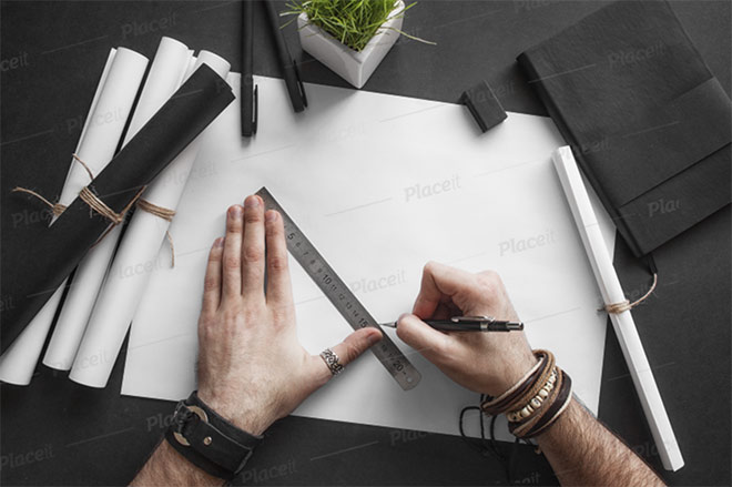 Mockup of a Man Tracing on a Sketch Paper